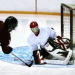 ice hockey goalie stopping shot