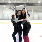 Willowbrook Ice Arena figure skating coaches holding up Willowbrook frame