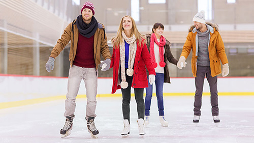 Public skaters holding hands
