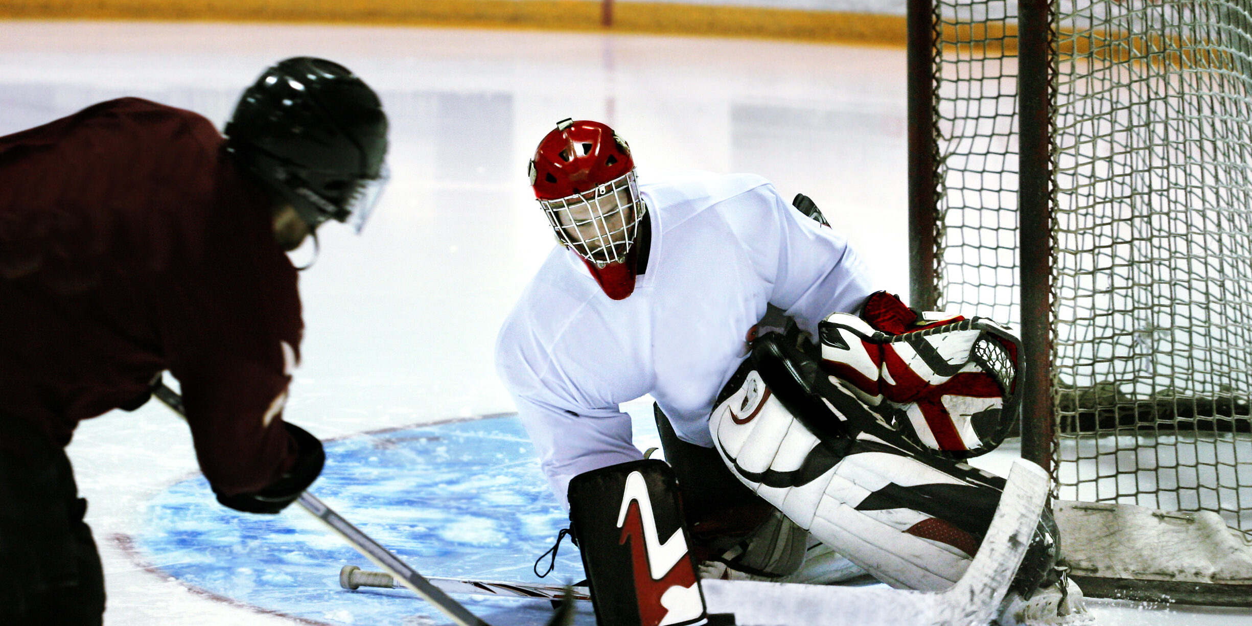 ice hockey goalie stopping shot